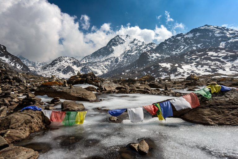 A Mountain In Nepal With Prayer Flags In The Foreground